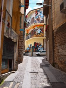 Street view with wall paintings in Orgosolo